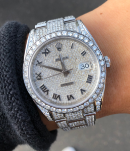 watch model: iced out rolex